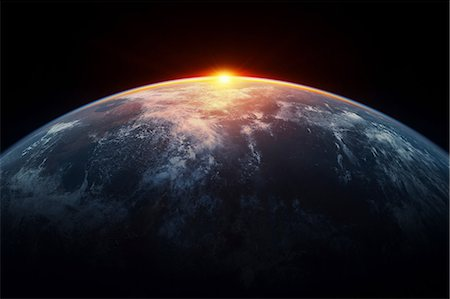 space - Sunlight eclipsing planet earth Stock Photo - Premium Royalty-Free, Code: 614-06813416