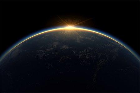Sunlight eclipsing planet earth Stock Photo - Premium Royalty-Free, Code: 614-06813417