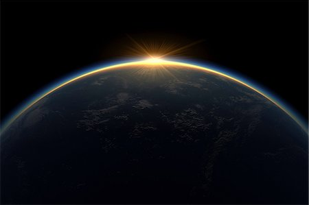 space - Sunlight eclipsing planet earth Stock Photo - Premium Royalty-Free, Code: 614-06813417