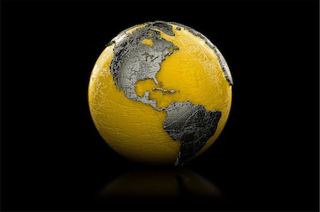Yellow and black globe North and South America Stock Photo - Premium Royalty-Free, Code: 614-06813410