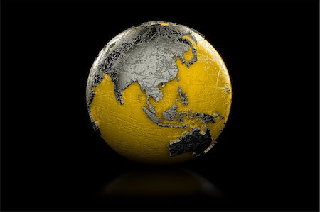 earth no people - Yellow and black globe Asia and Australia Stock Photo - Premium Royalty-Free, Code: 614-06813412