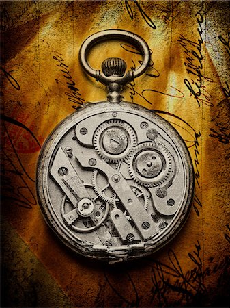 fragile - Pocket watch with open back on handwritten letter Stock Photo - Premium Royalty-Free, Code: 614-06813426