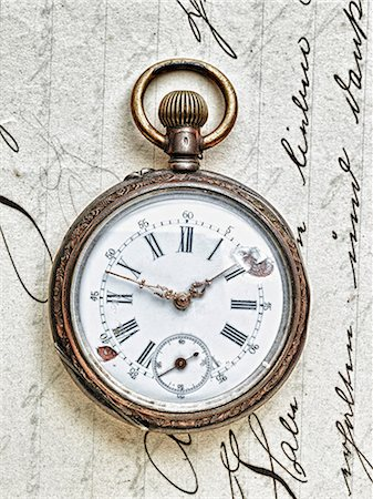 Pocket watch on handwritten letter Stock Photo - Premium Royalty-Free, Code: 614-06813427
