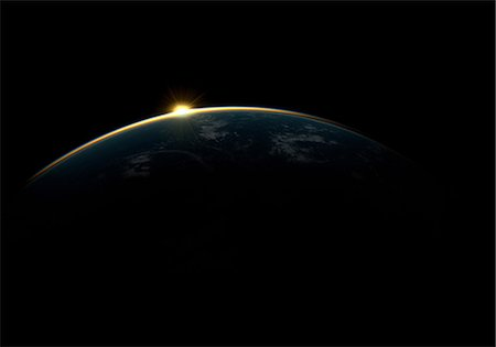 Sunlight eclipsing planet earth Stock Photo - Premium Royalty-Free, Code: 614-06813423