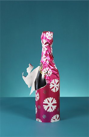 surprised - Bottle of bubbly wrapped in christmas paper Stock Photo - Premium Royalty-Free, Code: 614-06813440