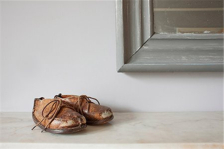 pair - Brown leather shoes on mantelpiece Stock Photo - Premium Royalty-Free, Code: 614-06813499