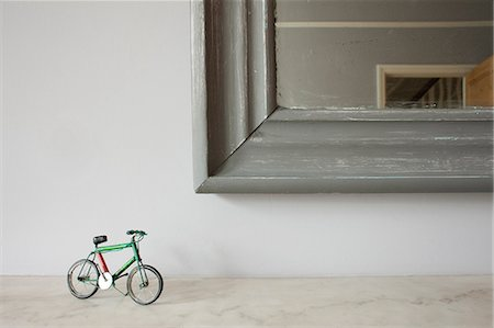 Miniature bicycle by mirror Stock Photo - Premium Royalty-Free, Code: 614-06813493