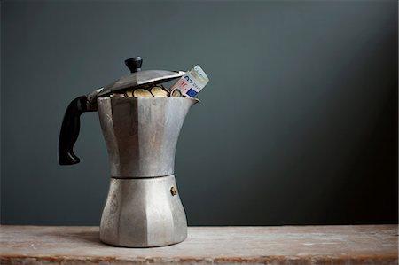 savings - Coffee pot with Euros inside Stock Photo - Premium Royalty-Free, Code: 614-06813505