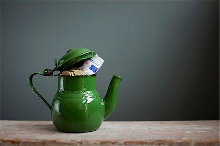 retro - Teapot with Euros inside Stock Photo - Premium Royalty-Free, Code: 614-06813506
