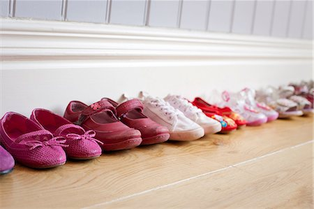 Child's shoes in a row Stock Photo - Premium Royalty-Free, Code: 614-06813508