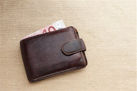 Brown leather wallet with ten Euro note Stock Photo - Premium Royalty-Free, Code: 614-06813516