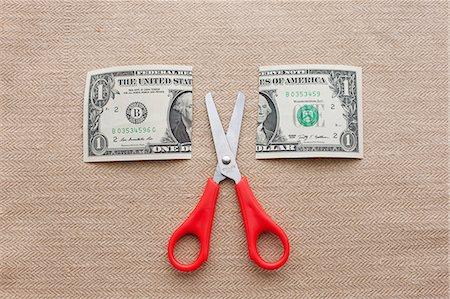 One dollar bill cut in half with scissors Stock Photo - Premium Royalty-Free, Code: 614-06813519