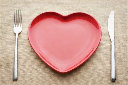Empty heart shaped plate Stock Photo - Premium Royalty-Free, Code: 614-06813512