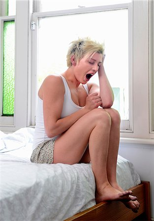 Young woman waking up Stock Photo - Premium Royalty-Free, Code: 614-06813544