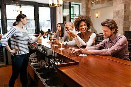 Customers drinking at bar Stock Photo - Premium Royalty-Free, Code: 614-06813625