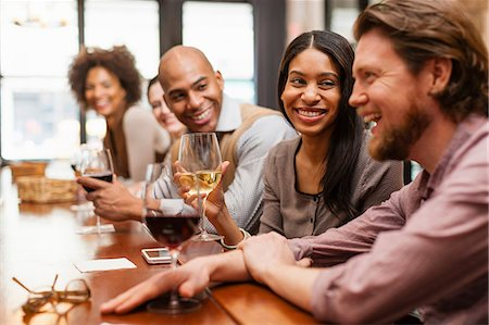 Friends chatting and laughing at bar Stock Photo - Premium Royalty-Free, Code: 614-06813627