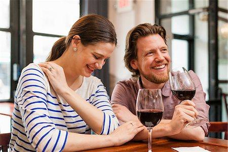 Couple at wine bar Stock Photo - Premium Royalty-Free, Code: 614-06813635