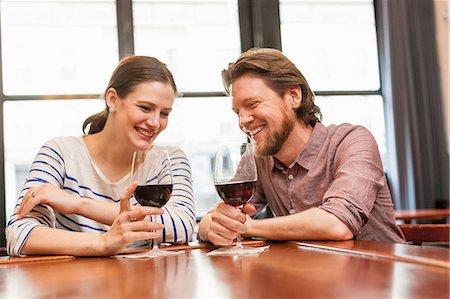 Couple at wine bar Stock Photo - Premium Royalty-Free, Code: 614-06813632