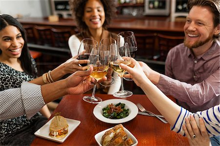 Friends at restaurant toasting Stock Photo - Premium Royalty-Free, Code: 614-06813680
