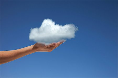 fragile - Hand holding cloud against blue sky Stock Photo - Premium Royalty-Free, Code: 614-06813705