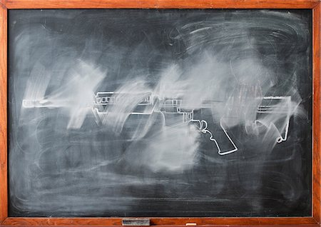 rectangle - Partially erased chalk drawing of gun on blackboard Stock Photo - Premium Royalty-Free, Code: 614-06813711