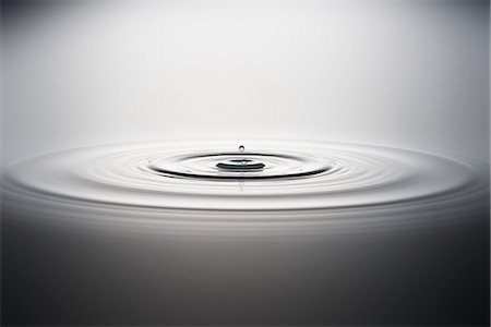 smooth - Water droplet falling into water Stock Photo - Premium Royalty-Free, Code: 614-06813720
