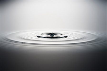 droplet - Water droplet falling into water Stock Photo - Premium Royalty-Free, Code: 614-06813721