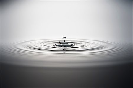 droplet - Water droplet falling into water Stock Photo - Premium Royalty-Free, Code: 614-06813722