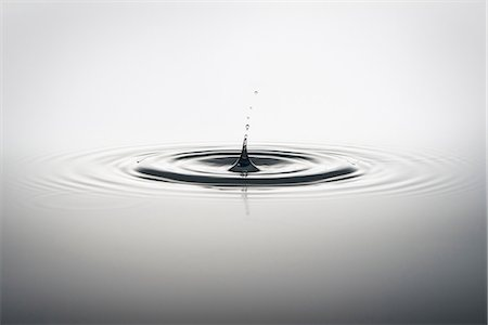 droplet - Water droplet falling into water Stock Photo - Premium Royalty-Free, Code: 614-06813723