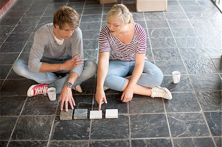 slate - Young couple sitting on floor choosing new tiles Stock Photo - Premium Royalty-Free, Code: 614-06813778