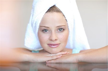 Young woman wearing towel on head with chin on hands Stock Photo - Premium Royalty-Free, Code: 614-06813801