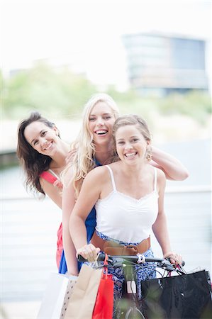 elegant - Three young women on a bicycle Stock Photo - Premium Royalty-Free, Code: 614-06813908
