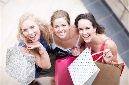 friendship - Three young women with their shopping bags Stock Photo - Premium Royalty-Free, Code: 614-06813912
