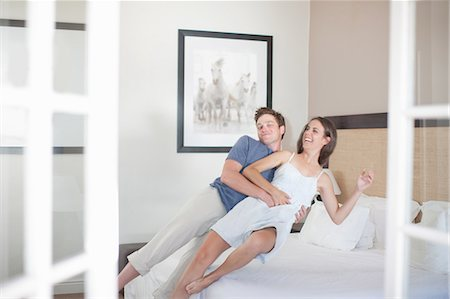 Young couple falling on bed Stock Photo - Premium Royalty-Free, Code: 614-06813945