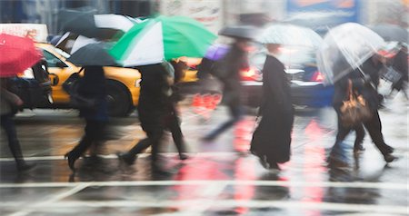 people with umbrellas in the rain - Line of people crossing city street in rain Stock Photo - Premium Royalty-Free, Code: 614-06895649
