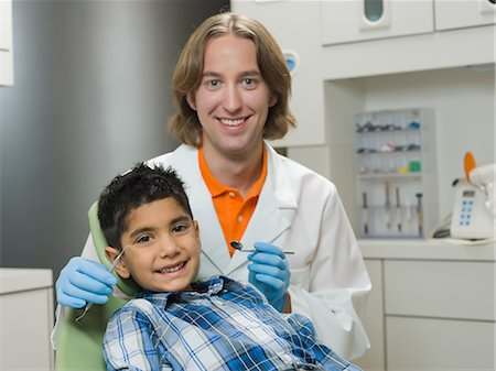 Dentist and young boy smiling, portrait Stock Photo - Premium Royalty-Free, Code: 614-06895742