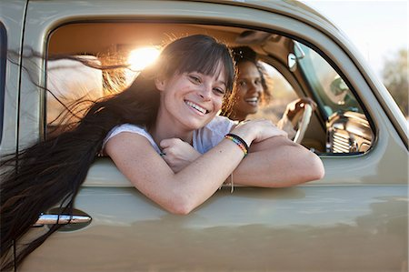 Young women travelling in car on road trip, portrait Stock Photo - Premium Royalty-Free, Code: 614-06896254