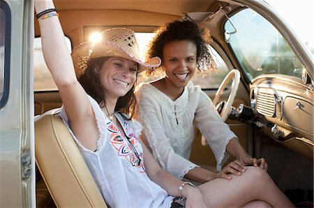 Young women sitting in car on road trip, portrait Stock Photo - Premium Royalty-Free, Code: 614-06896253