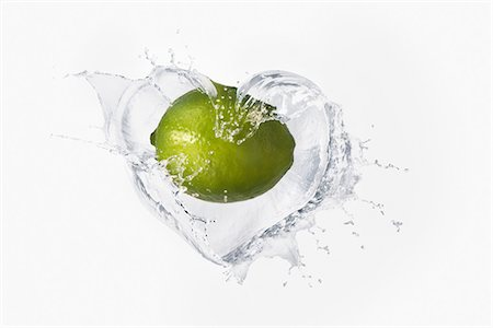 Lime splashing in liquid Stock Photo - Premium Royalty-Free, Code: 614-06896431