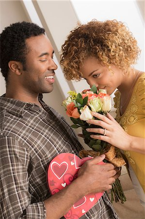 Man giving woman flowers and chocolates on valentines day Stock Photo - Premium Royalty-Free, Code: 614-06896476