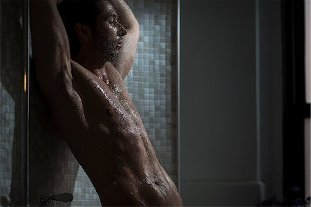 Mid adult male taking a shower Stock Photo - Premium Royalty-Free, Code: 614-06896560