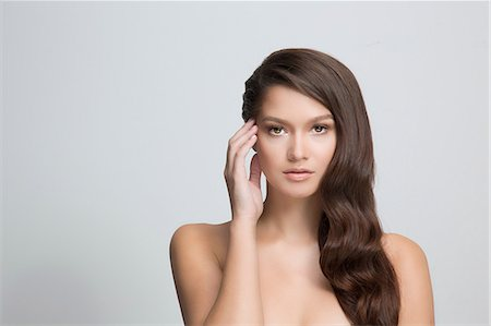 pretty - Portrait of brunette woman touching face Stock Photo - Premium Royalty-Free, Code: 614-06896615