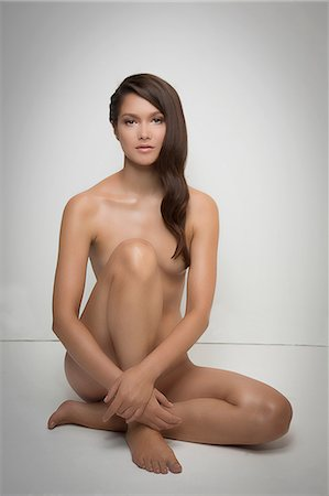 Portrait of naked woman sitting on floor Stock Photo - Premium Royalty-Free, Code: 614-06896619