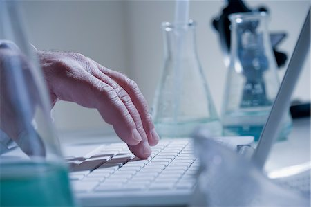 Scientist  using laptop in laboratory Stock Photo - Premium Royalty-Free, Code: 614-06896634