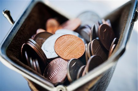 savings - Purse filled with coins Stock Photo - Premium Royalty-Free, Code: 614-06896640