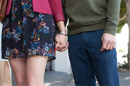 picture - Young couple holding hands, mid section Stock Photo - Premium Royalty-Free, Code: 614-06896733