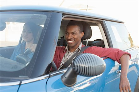 Young couple in car Stock Photo - Premium Royalty-Free, Code: 614-06896787