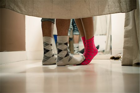 Young couple wearing socks in changing room, low section Stock Photo - Premium Royalty-Free, Code: 614-06896782