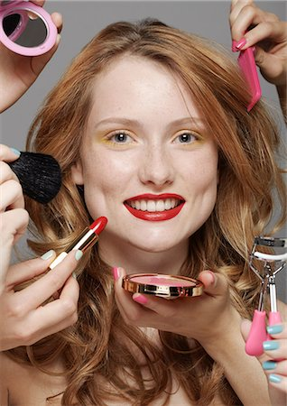 Young woman with make-up artists Stock Photo - Premium Royalty-Free, Code: 614-06896832
