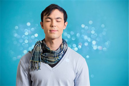Portrait of young man wearing blue jumper and scarf Stock Photo - Premium Royalty-Free, Code: 614-06896858